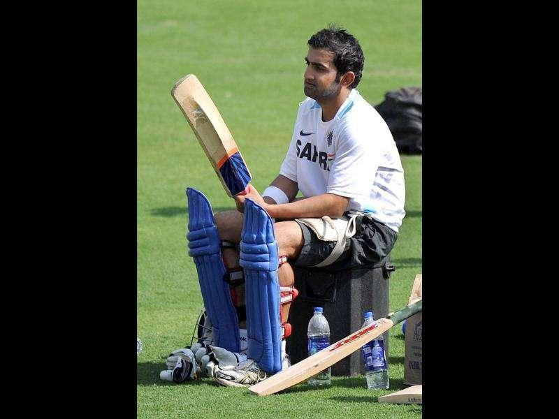 Gautam Gambhir checks a bat during a practise session at The Holkar Stadium in Indore. AFP Photo