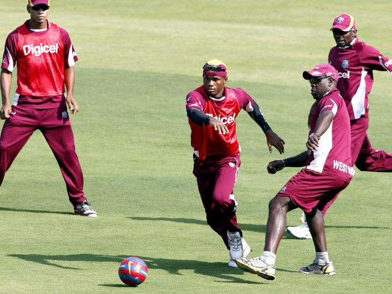 West Indies' Powell, Samuels, coach Gibson and Hyatt play football during the team practice session prior to their 4th ODI against India at Holkar stadium in Indore. HT photo/Santosh Harhare