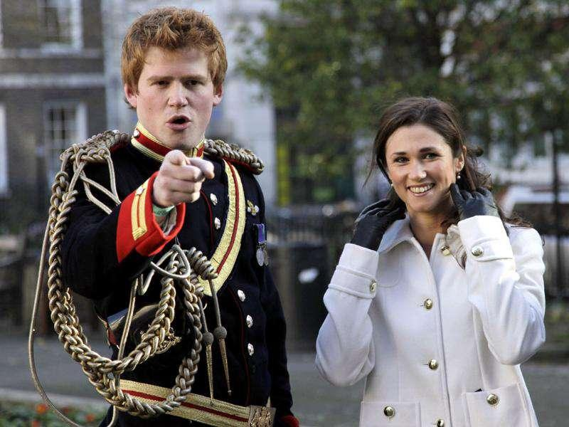 Lookalikes of Britain's Prince Harry and Pippa Middleton pose in a park during a media event to promote a new book by photographer Alison Jackson, in London. Reuters Photo