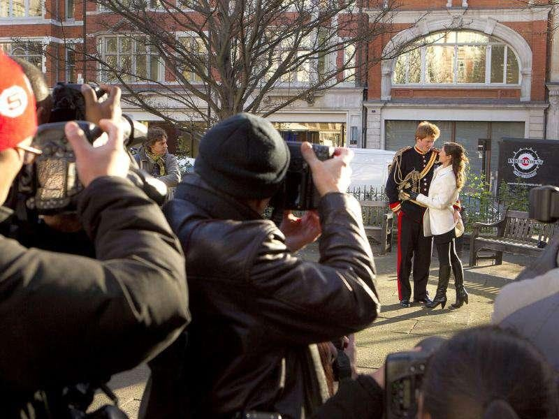 Photographers gather to click Royal lookalikes of Prince Harry and Pippa Middleton, as they get close in a small park square in central London, to launch the new book, Exposed, by British artist and photographer Alison Jackson, known for her lookalike pictures of celebrities. AP Photo