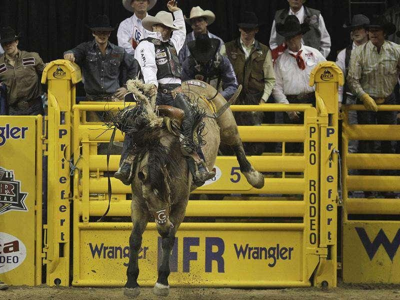 Bradley Harter of Weatherford, Texas competes in the saddle bronc competition during the seventh go-round of the National Finals Rodeo in Las Vegas.
