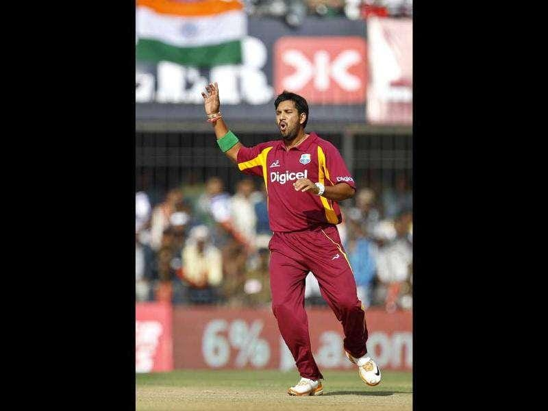 West Indies' bowler Ravi Rampaul reacts after bowling a delivery during their fourth one day international cricket match against India in Indore. AP Photo