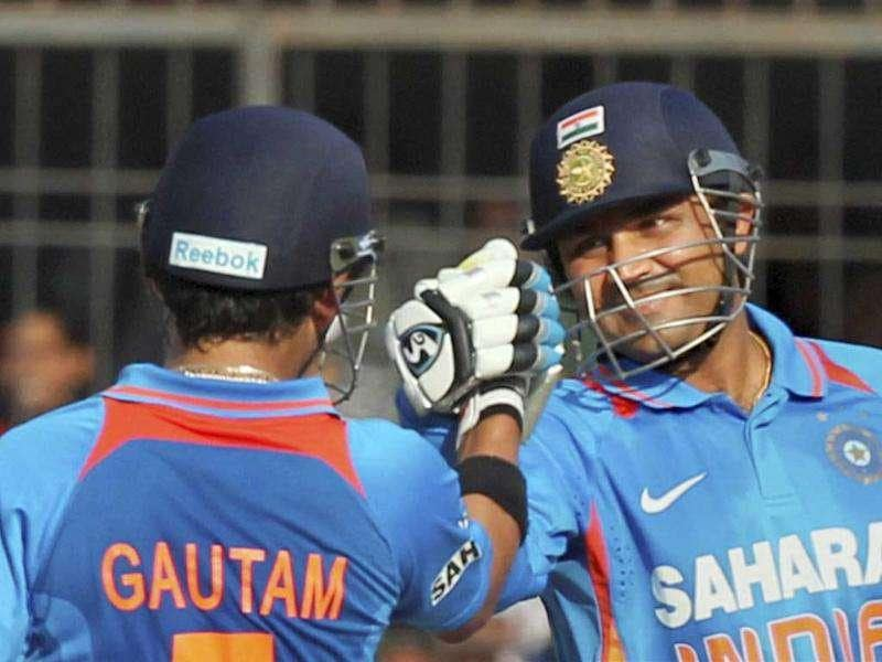 Virender Sehwag and Gautam Gambhir during the 4th ODI cricket match against West Indies at the Holkar stadium in Indore. PTI Photo