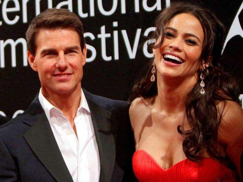 Tom Cruise and Paula Patton pose for the cameras. (AFP)
