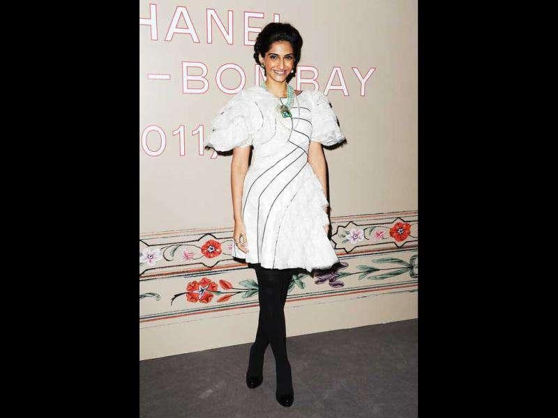 In January, Sonam visited the Elie Saab Paris Couture Week on the special invitation of French haute couturer, Jean Paul Gaultier. Sonam Kapoor wore a black and white dress from Chanel's spring 2012 collection at Paris Fashion Week.