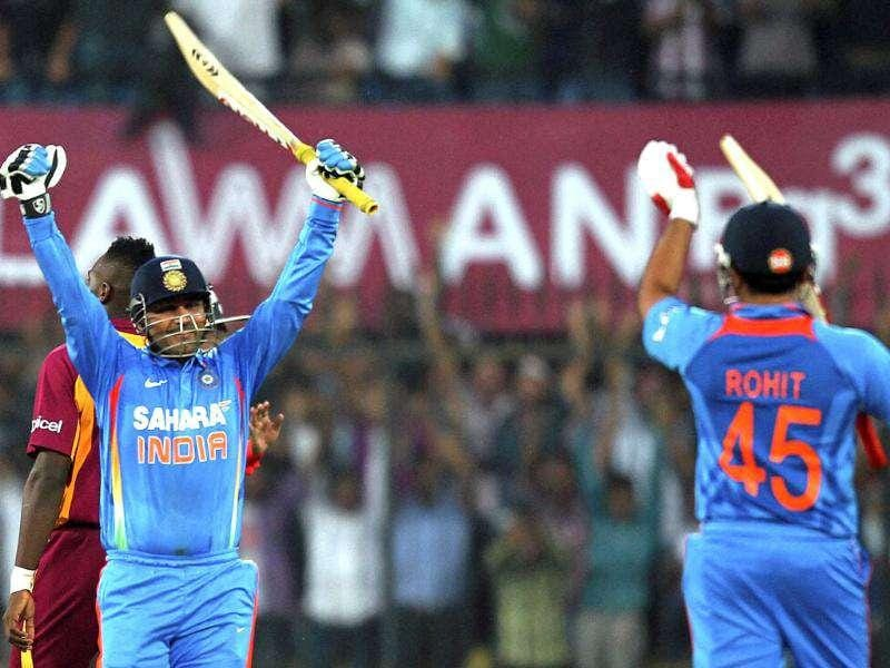 Virender Sehwag celebrates his double century during the 4th ODI cricket match against West Indies in Indore. PTI Photo