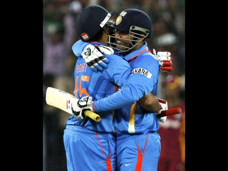 Virender Sehwag (R) is congratulated by teammate Rohit Sharma after scoring 200 runs during their fourth one-day international cricket match against West Indies in Indore. Reuters Photo