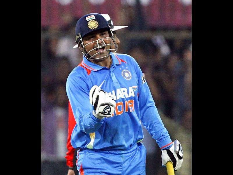 Sehwag celebrates his double hundred during the 4th ODI between India and West Indies at Holkar Stadium in Indore. HT Photo/Santosh Harhare