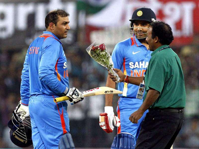 Sehwag gets flowers from a fan after scoring a double hundred against West Indies in Indore. HT Photo/Santosh Harhare