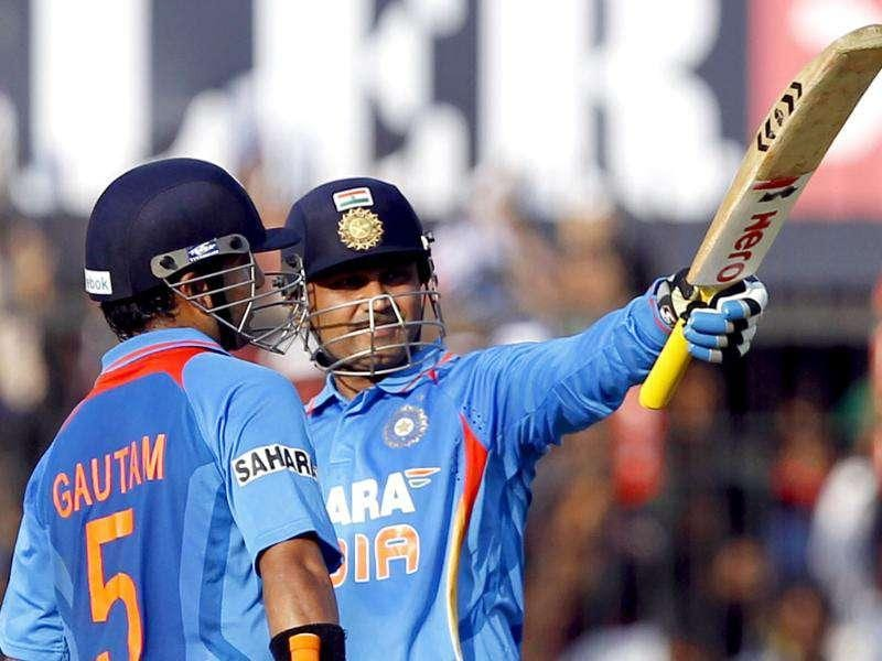 Gautam Gambhir congratulates Virender Sehwag after his century during the 4th ODI between India and West Indies at Holkar Stadium in Indore. HT Photo/Santosh Harhare