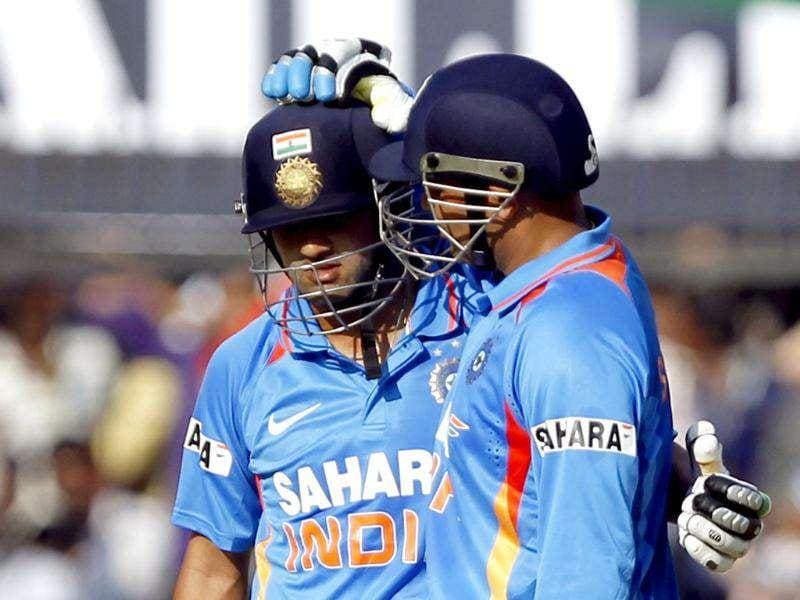 Sehwag congratulates Gambhir after his half century during the 4th ODI between India and West Indies at Holkar Stadium in Indore. HT Photo/Santosh Harhare