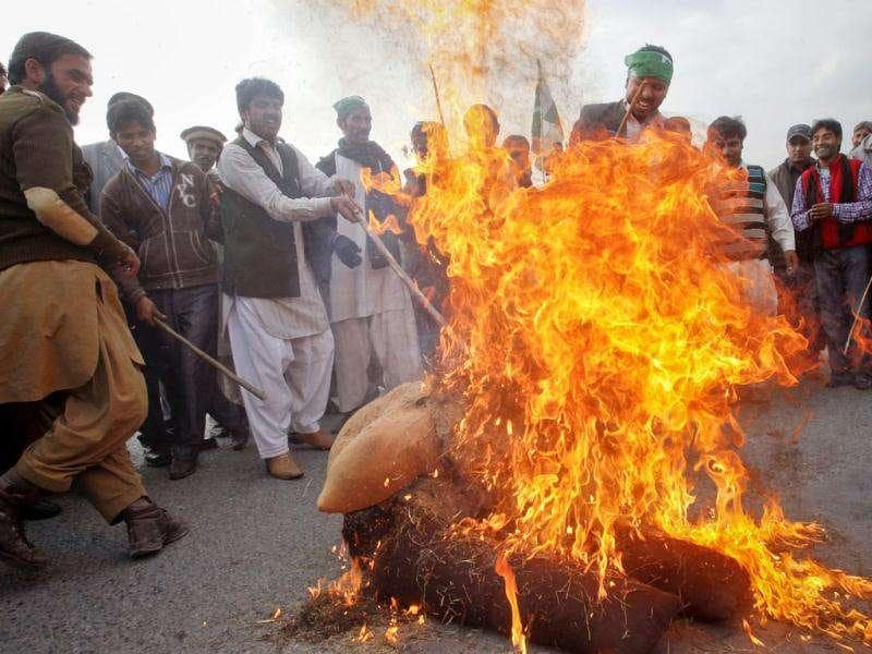 Protesters burn an effigy representing the Nato, during a rally in support of Pakistan army in Islamabad. Reuters/Faisal Mahmood