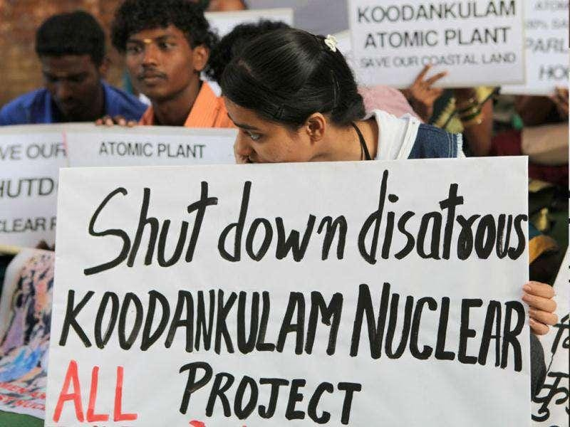 Activists hold placards during an anti-nuclear protest at Jantar Mantar in New Delhi. Various organisations held a protest to demand the scrapping of nuclear projects which are endangering the safety and livelihood of people. HT Photo by Vipin Kumar