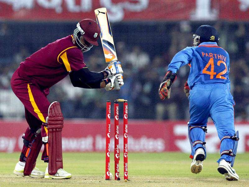 West Indies batsman Samuels is bowled by Rahul Sharma during their 4th ODI at Holkar Stadium in Indore. HT photo/Santosh Harhare