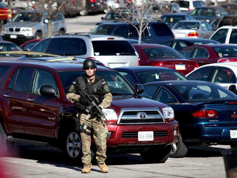 A police officer secures the scene where a gunman killed a police officer and another person after a traffic stop on the campus of Virginia Tech, in Blacksburg. AP Photo