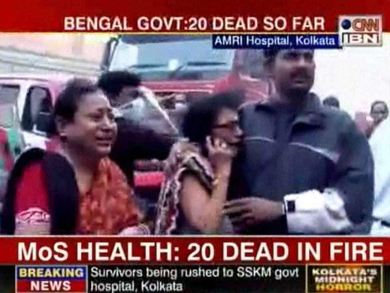 TV grab of families of patients, trapped inside AMRI hospital, standing outside the hospital in Kolkata.