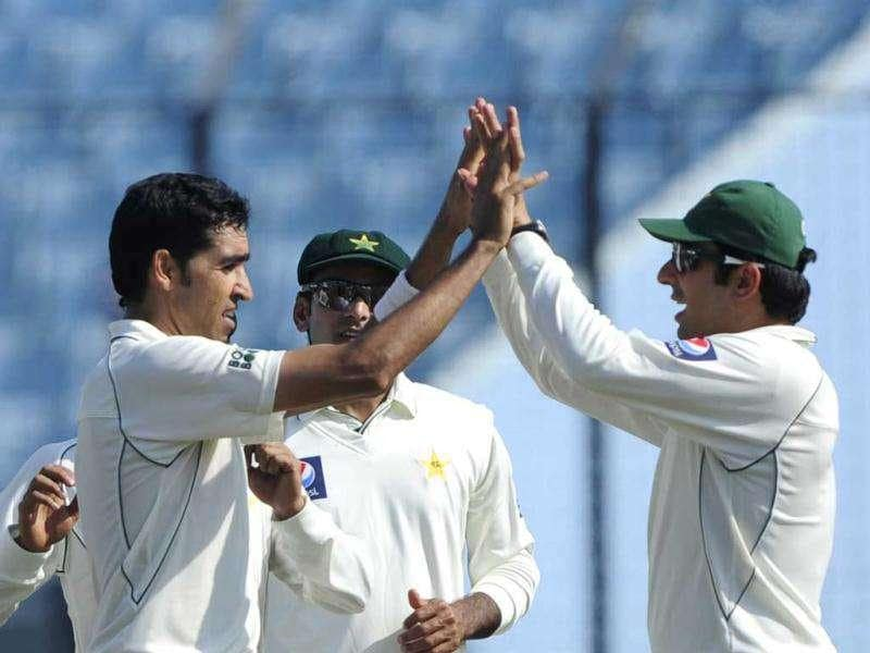Pakistani cricketer Umar Gul (L) celebrates with his captain Misbah-ul-Haq (R) after the dismissal of the unseen Bangladeshi batsman Mohammad Ashraful during the first day of the first cricket Test match between Bangladesh and Pakistan at The Zahur Ahmed Chowdhury Stadium in Chittagong. AFP PHOTO/Munir uz ZAMAN