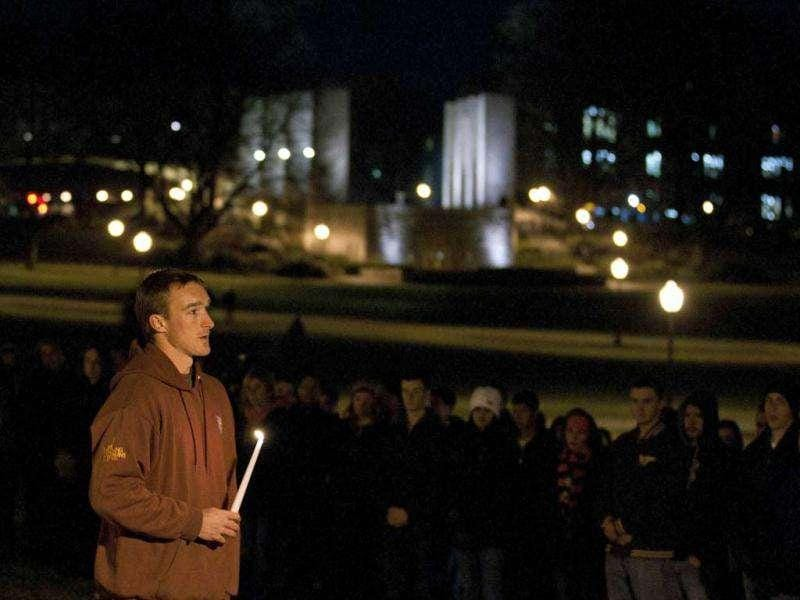 Virginia Tech student Chris Mundy speaks to fellow students at an impromptu memorial for the Virginia Tech police officer who was killed earlier on campus at Virginia Tech University Blacksburg, Virginia. (Reuters/Chris Keane)