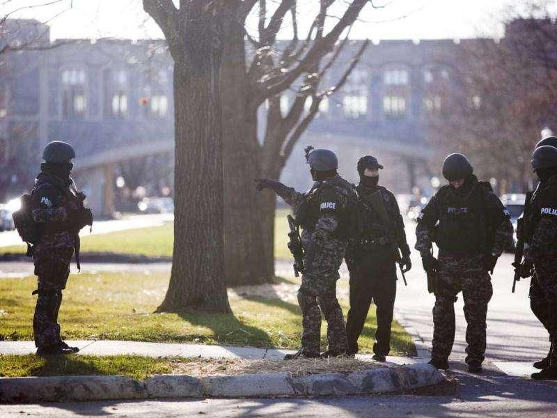Police secure the perimeter of Virginia Tech campus in Blacksburg, Va. as the investigation continues after a gunman walked into a parking lot and killed a Virginia Tech police officer who was conducting a traffic stop. (AP Photo/The Roanoke Times, Sam Dean)