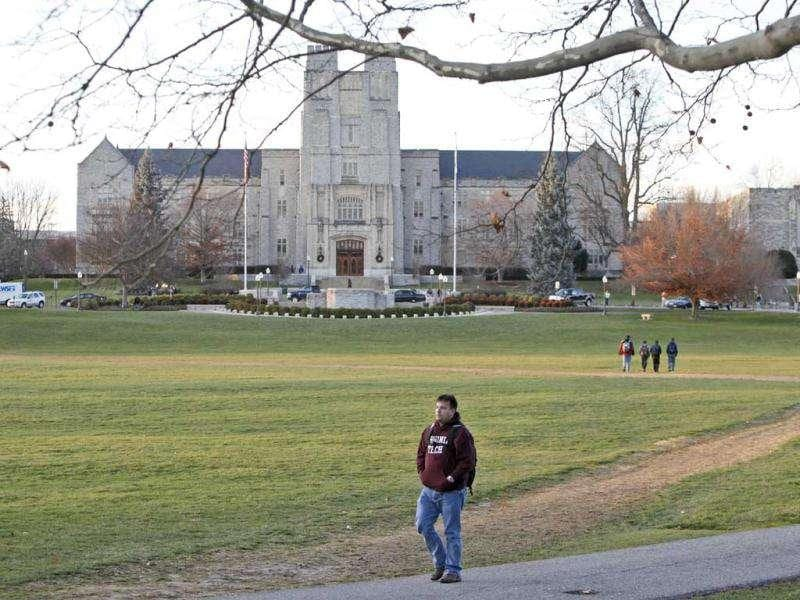 Students return to activities, after school officials declared the campus safe from two earlier shootings, in Blacksburg, Va. (AP Photo/Steve Helber)