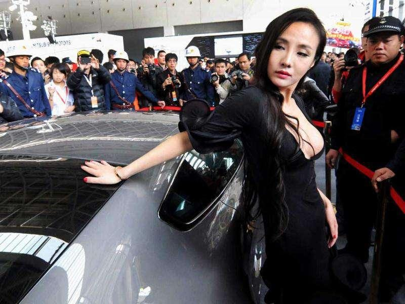 Chinese internet celebrity Gan Lulu poses at the ASEAN International Auto Show in Nanning, south China's Guanxi Province. China out AFP Photo