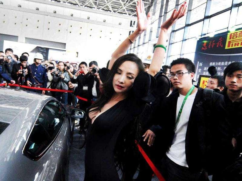 Chinese internet celebrity Gan Lulu strikes a pose at the ASEAN International Auto Show in Nanning, south China's Guanxi Province. China out AFP Photo