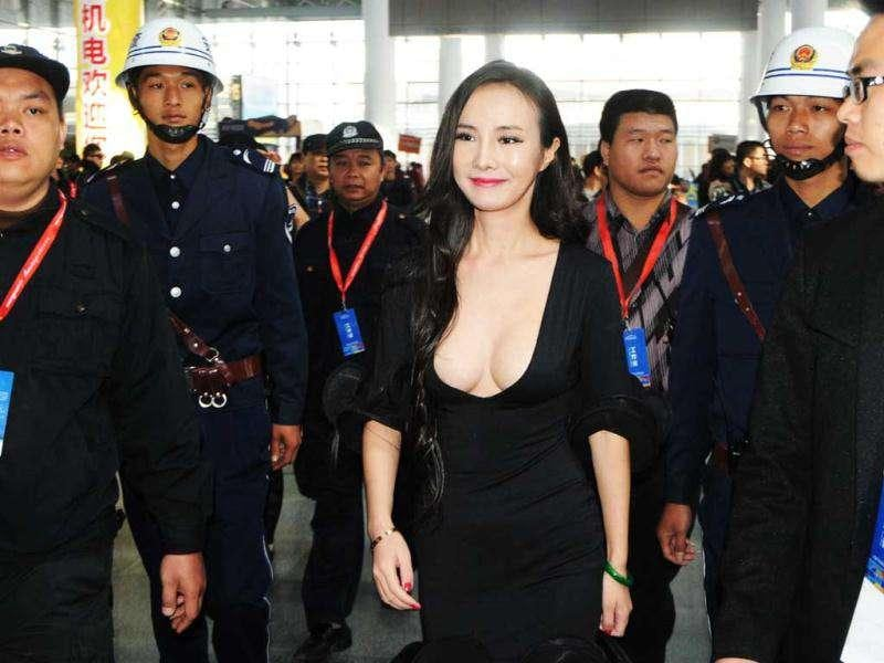 Gan Lulu, in a revealing outfit, attends the ASEAN International Auto Show in Nanning, south China's Guanxi Province. China out AFP Photo