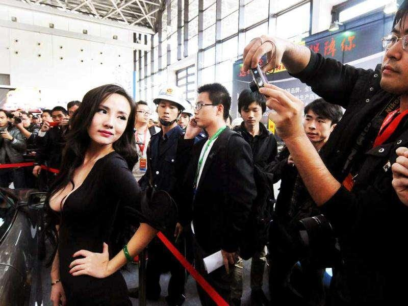Chinese internet celebrity Gan Lulu at the ASEAN International Auto Show in Nanning, south China's Guanxi Province. Gan Lulu became famous in China after her mother filmed her naked in what they claim was an attempt to find her a husband using the internet. China out AFP Photo