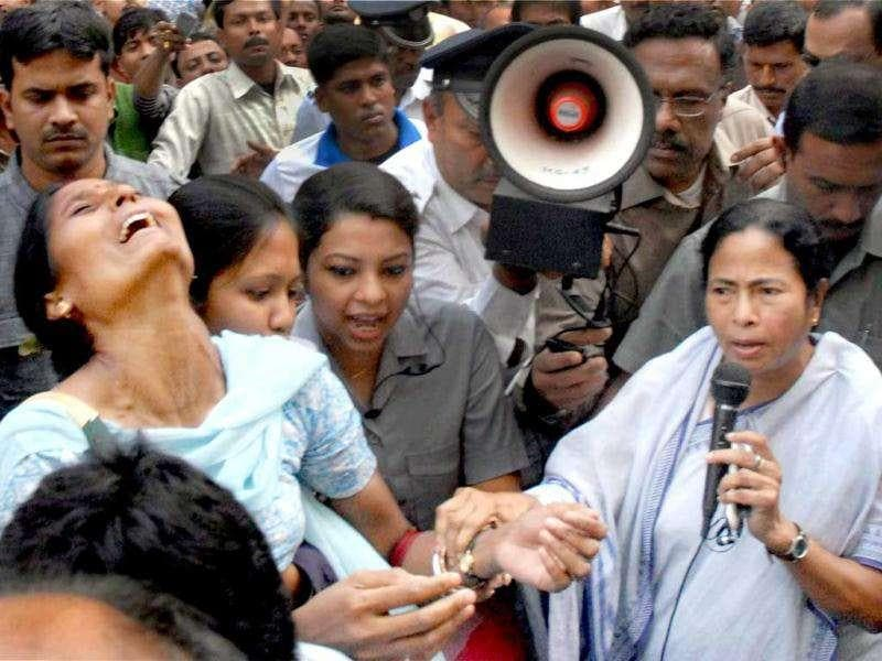 West Bengal chief minister Mamata Banerjee consoles a relative of a patient at the AMRI Hospital in Kolkata. PTI
