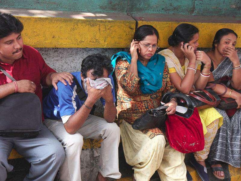 Relatives of the victims grieve outside AMRI hospital in Kolkata where fire broke out killing over 73 people. HT PHOTO/ Subhankar Chakraborty