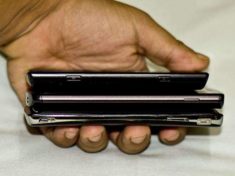Comparing the sizes. From top to bottom - Samsung Omnia W, Samsung Wave III, and Sony Xperia Arc S.