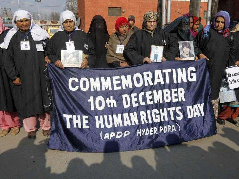 Members of the Association of Parents of Disappeared Persons (APDP) hold a banner during a demonstration to mark International Human Rights Day, in Srinagar.Reuters/Fayaz Kabli