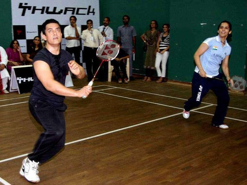 Aamir Khan and Saina Nehwal during a game at the book launch.