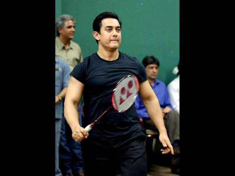 Aamir Khan plays badminton in an exhibition game.