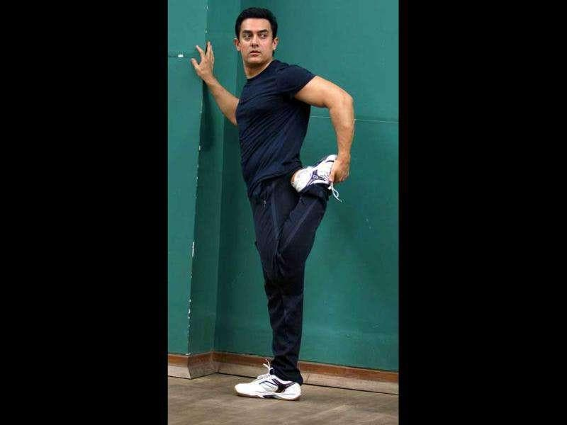 Aamir looks sporty in a black track pants and a t-shirt.