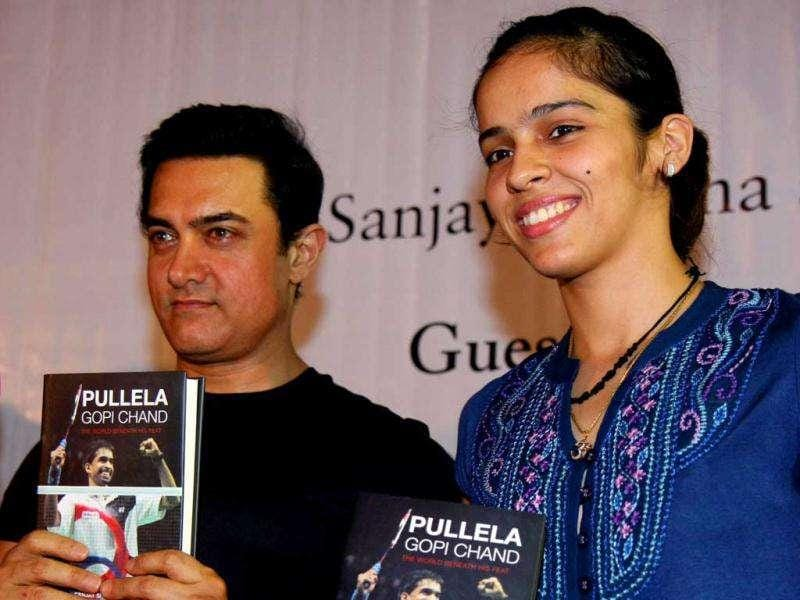 After becoming a father to a new born, Aamir made his first public appearance at the launch of Pullela Gopi Chand: The World Beneath His Feat, a biography of Pullela Chand along with Saina Nehwal. See event pics!
