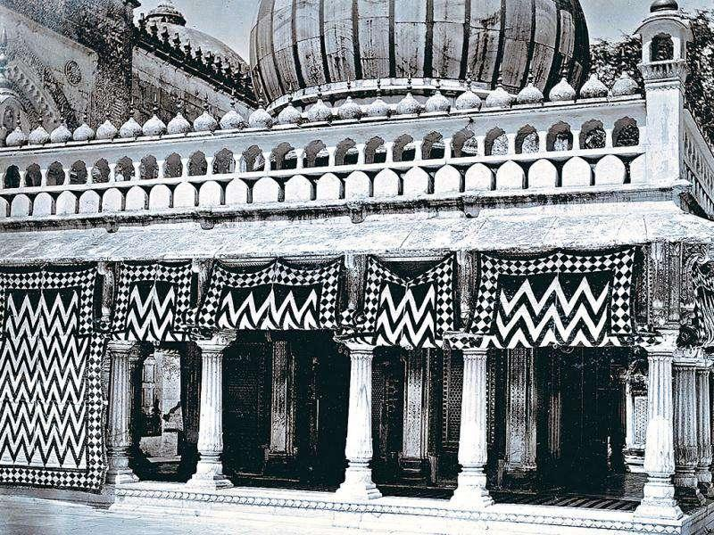 The Shrine of Nizamuddin Auliya, 1890: Photograph by GW Lawrie & Co., 1890s. The hangings make for a most striking pattern round the shrine. Courtesy: British Library, London