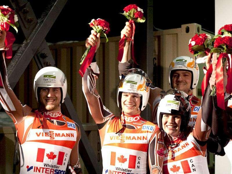 (From L to R) Team Canada's Tristan Walker, Justin Snith, Alex Gough and Samuel Edney celebrate their team's second-place finish in the relay luge event at the World Cup at the Whistler Sliding Centre in Whistler, British Columbia. (AP Photo/The Canadian Press, Jonathan Hayward)