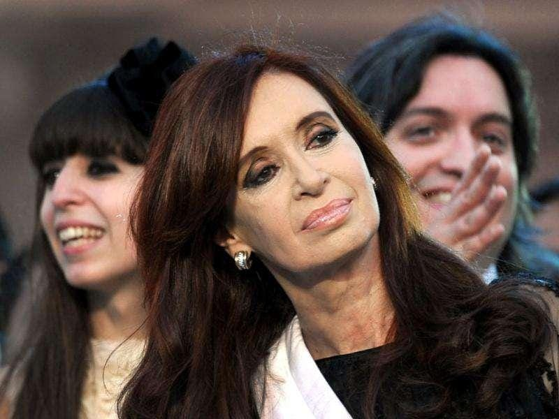 Argentina's reelected President Cristina Fernandez de Kirchner (C) looks next to her daughter Florencia (L) and her son Maximo (R) during her inauguration ceremony, in Mayo square, Buenos Aires. AFP Photo/Daniel Garcia