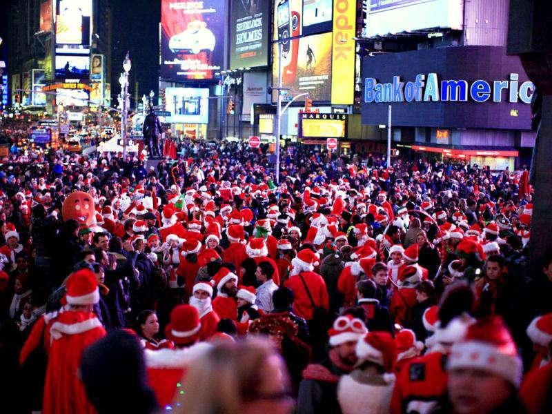 Thousand of people dressed in Santa Claus costume gather at Times Square during the annual SantaCon celebration in New York. REUTERS/Kena Betancur