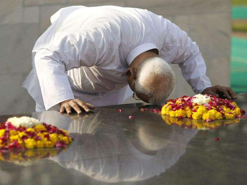 Anti-corruption activist Anna Hazare, 74, pays respects at the memorial to Mahatma Gandhi at Rajghat in New Delhi. AP Photo/Mustafa Quraishi