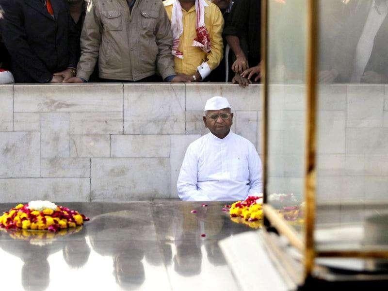 Anti-corruption activist Anna Hazare, 74, meditates as he sits at the memorial to Mahatma Gandhi at Rajghat in New Delhi. AP Photo/Mustafa Quraishi