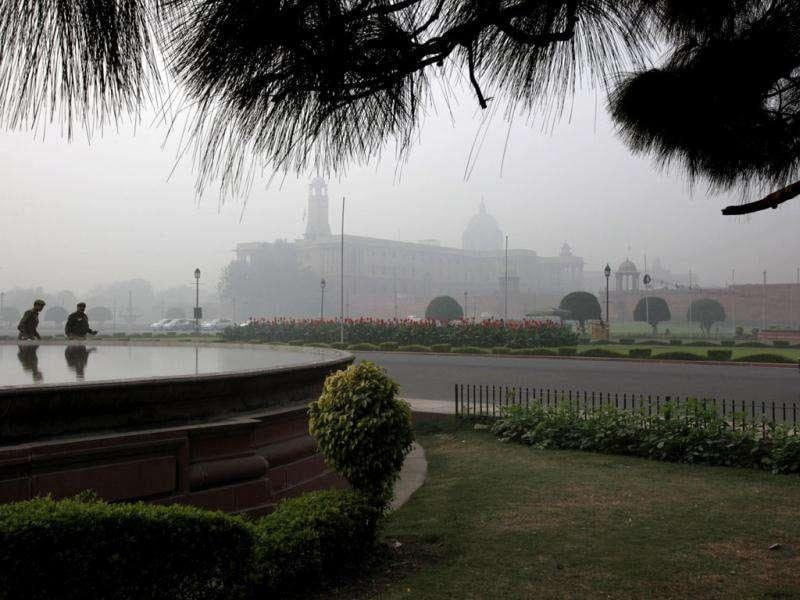 Two policemen walk past the country's seat of power South Block in New Delhi. AP Photo/Manish Swarup