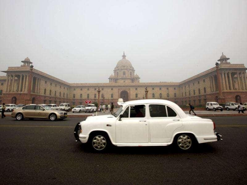 An ambassador car drives past the country's seat of power South Block, built by the British in New Delhi.AP Photo/Manish Swarup