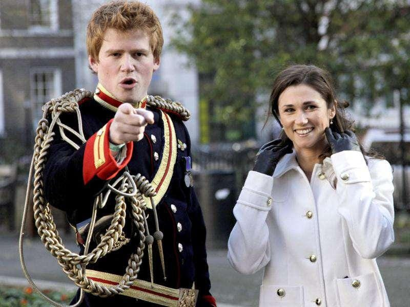 Lookalikes of Britain's Prince Harry and Pippa pose in a park during a media event in London. Stefan Wermuth/Reuters