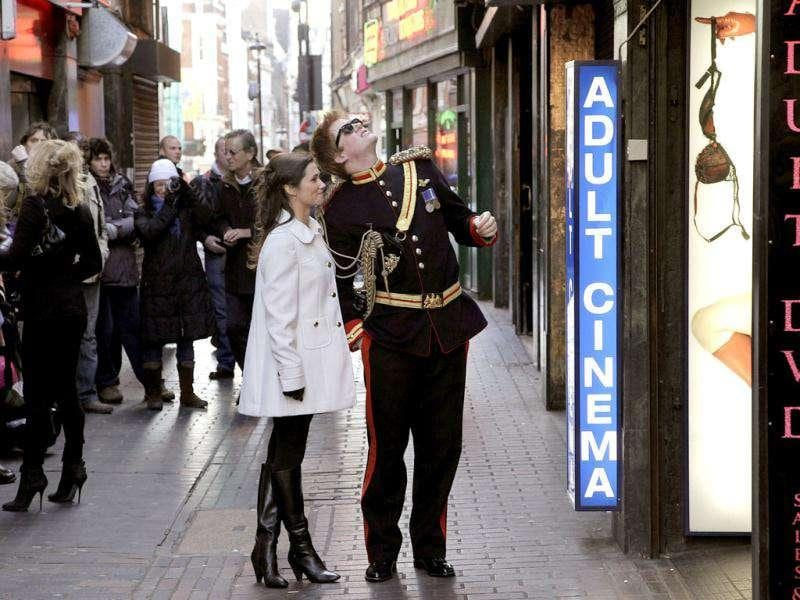 Lookalikes of Britain's Prince Harry and Pippa pose outside an adult shop during a media event in London. Stefan Wermuth/Reuters