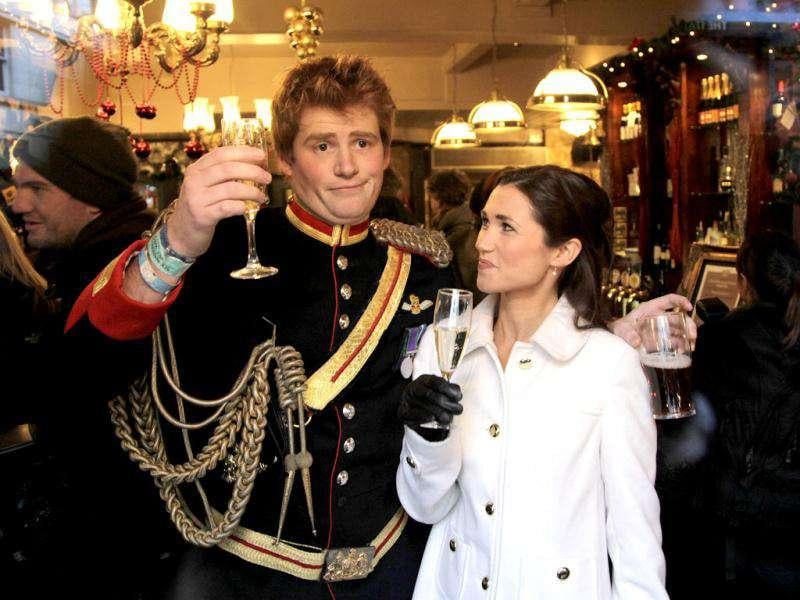Lookalikes of Britain's Prince Harry and Pippa pose in a pub during a media event in London. Stefan Wermuth/Reuters