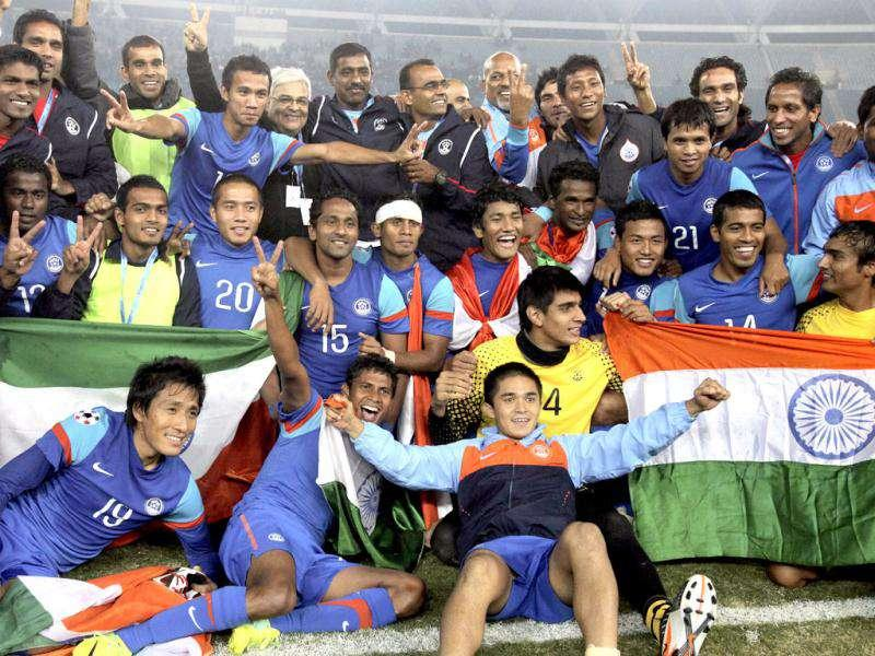 Indian football team players and officials celebrate after beating Afghanistan by 4-0 in their final match of the SAFF championship 2011 at Nehru stadium in New Delhi.