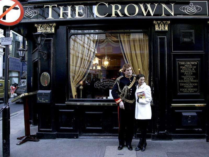 Lookalikes of Britain's Prince Harry and Pippa pose outside a pub during a media event in London. Stefan Wermuth/Reuters