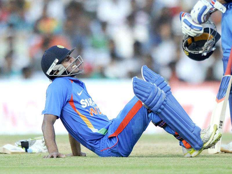 Manoj Tiwary sits on the ground due to cramps during the final ODI cricket match between India and West Indies in Chennai.
